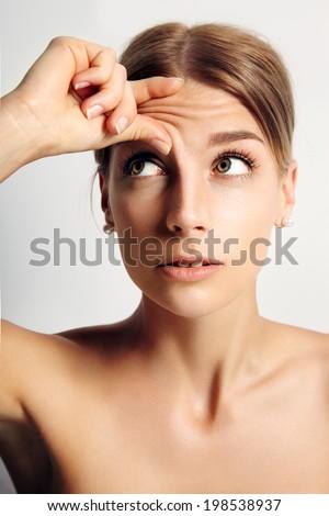 girl wrinkle her forehead - stock photo