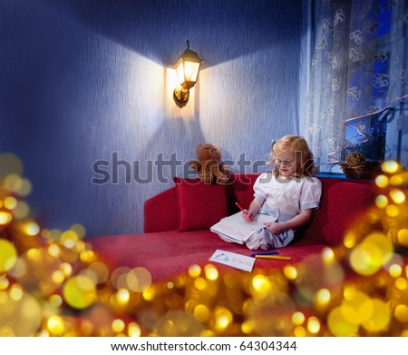 girl writing a letter to Santa Claus - stock photo