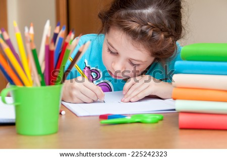 Girl writing at a desk - stock photo