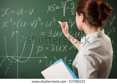 girl writing the mathematical formulas on a chalkboard - stock photo