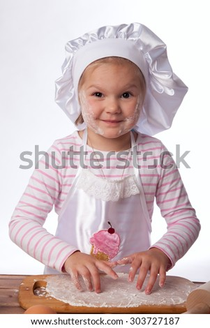 girl 4 years old cooking - stock photo