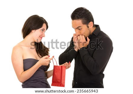 girlfriend surprises boyfriend with a gift isolated on white - stock photo