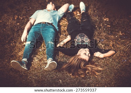 Girlfriend with her boyfriend outdoor in the forest - stock photo