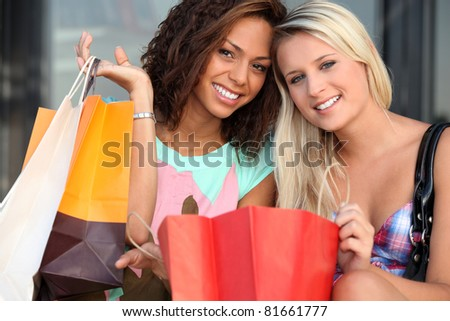 girls after shopping frenzy - stock photo