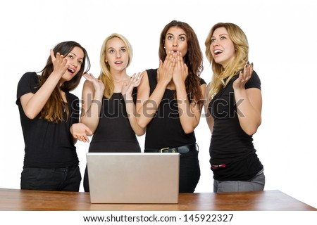 Girls and a laptop looking up with white background - stock photo