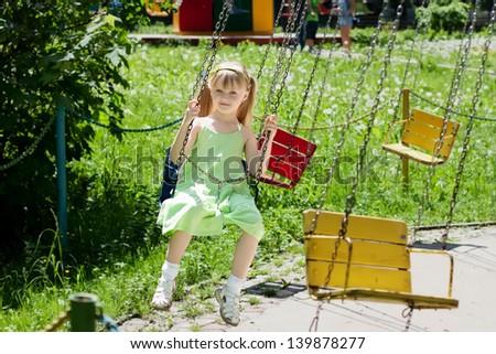 Girls are having fun at merry-go-round - stock photo
