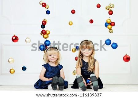 Girls at Christmas time at studio - stock photo