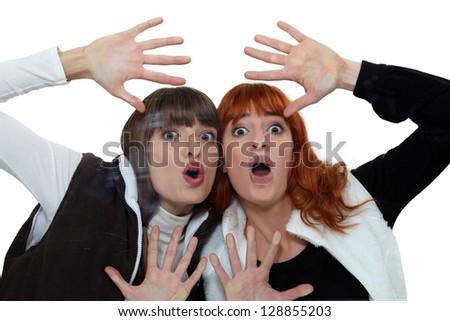 Girls behind glass - stock photo