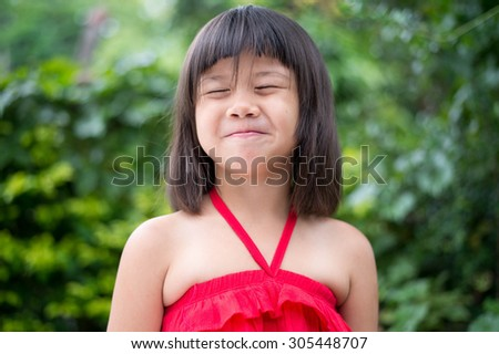 Girls ,cheerful, mood, happy, kid, girl, pretty, childhood, asian, happy, asian, little,beautiful, portrait, red, thoughtful, musing, pensive, dress, calm, quiet, cute, daydream, reverie,  - stock photo