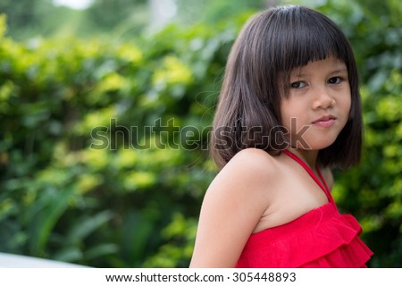 Girls, cheerful mood, happy, kid, girl, pretty, childhood, asian, happy, asian, little,beautiful, portrait, red, thoughtful, musing, pensive, dress, calm, quiet, cute, daydream, reverie,  - stock photo
