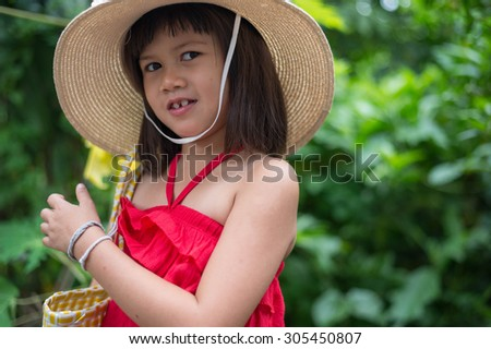Girls, cheerful, mood, happy, kid, girl, pretty, childhood, asian, happy, asian, little,beautiful, portrait, red, thoughtful, musing, pensive, dress, calm, quiet, cute, daydream, reverie,  - stock photo