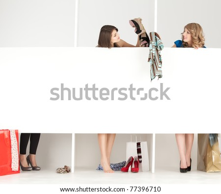 girls discussing over clothes in shop wordrobe - stock photo