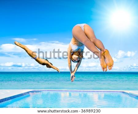 Girls dive - stock photo