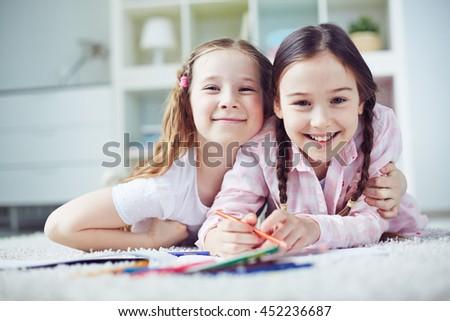 Girls drawing - stock photo