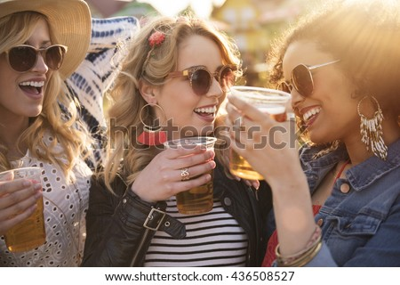 Girls drinking beer at the party - stock photo