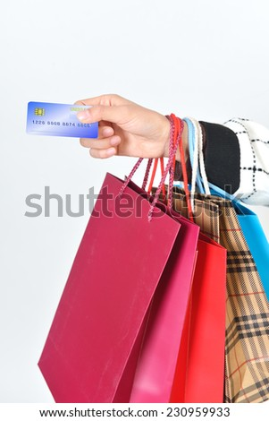 Girls hand over credit cards. Hands and shopping bags feature - stock photo