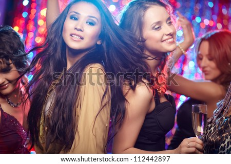 Girls having fun at club tonight - stock photo