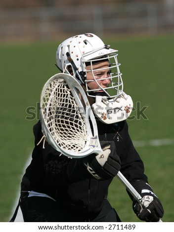 Girls high school lacrosse goalie. Editorial use only. - stock photo