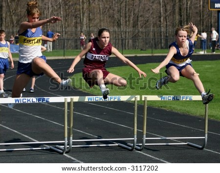 Girls hurdles race - stock photo