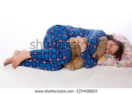 Girls in blue pajama sleeping on white - stock photo