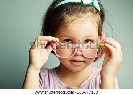 Girls in children's glasses - stock photo