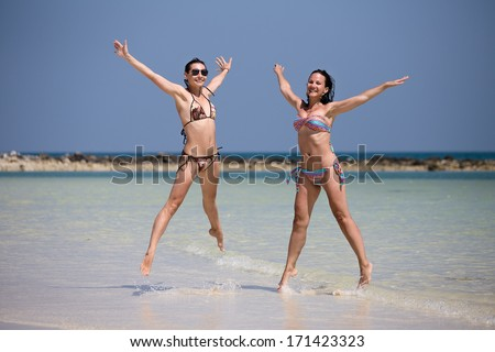 Girls on the beach on a sunny day - stock photo