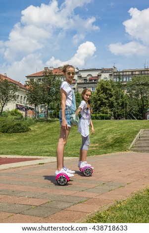 Girls on the hoverboard - stock photo