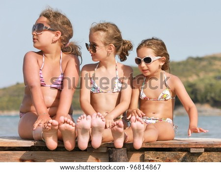 Girls on the wooden pier - stock photo