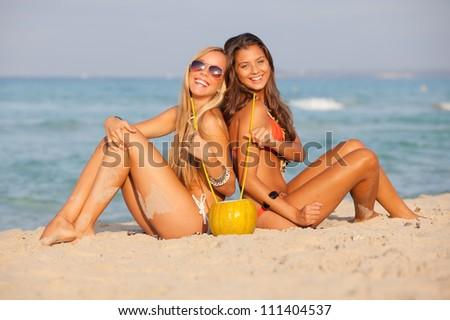 girls or teens on spring break drinking - stock photo