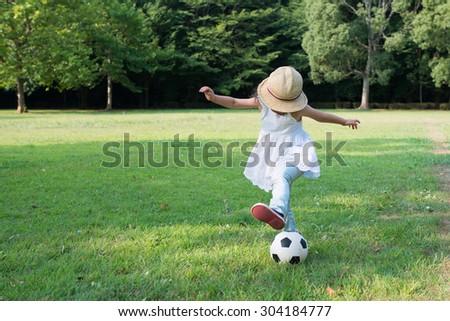 Girls play soccer - stock photo