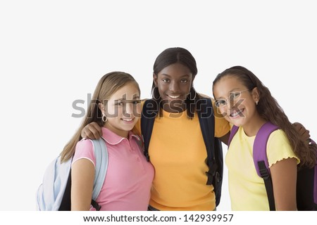 Girls posing for the camera together - stock photo