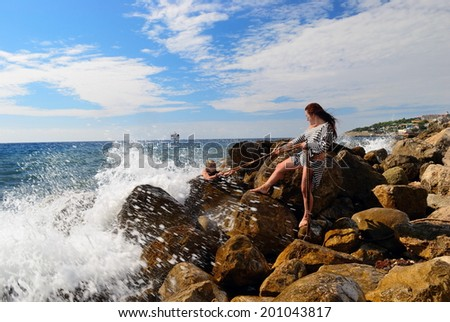 Girls rescued after shipwreck - stock photo