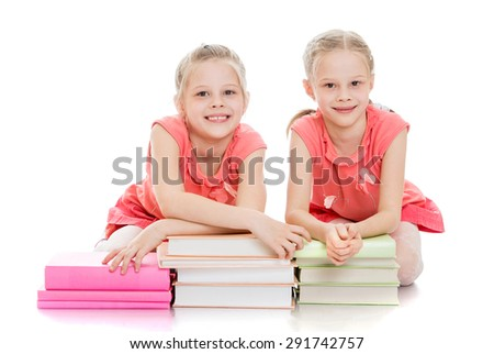 Girls schoolgirl with lots of books - isolated on white background - stock photo