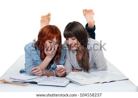 girls sharing secrets - stock photo
