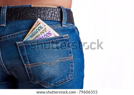 Girls Shows her money inside her Jeans Back Pocket - stock photo