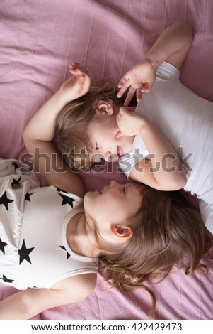 girls sisters siblings play, hug, relationships sisters, close up, domestic real situation, the concept of childhood, lifestyle, - stock photo