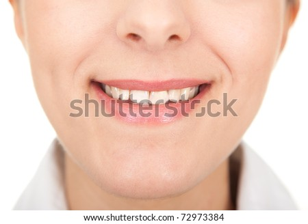 girls smiling  with a visible teeth closeup - stock photo