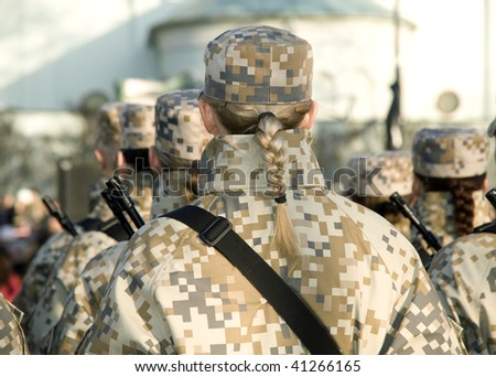 Girls soldiers on parade - stock photo