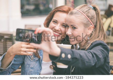 Girls Taking Pictures with Mobile Phone - stock photo