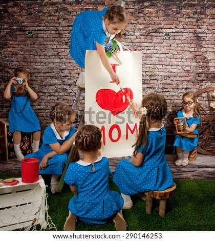 """Girls twin poster paint with a big heart """"I love mom"""". Collage. - stock photo"""
