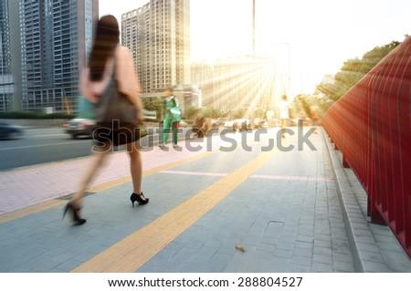 Girls walking to work in Guangzhou, China  - stock photo