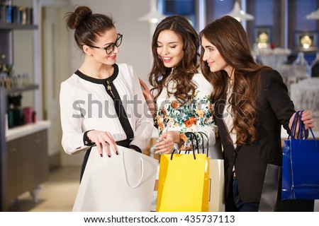Girls with bags in a boutique. - stock photo