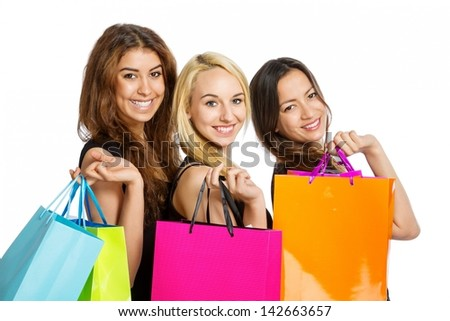 Girls with shopping bags over their shoulder on white background - stock photo