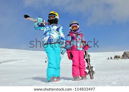 Girls with ski on the snow - stock photo