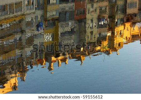 Girona reflected in the onya river - stock photo