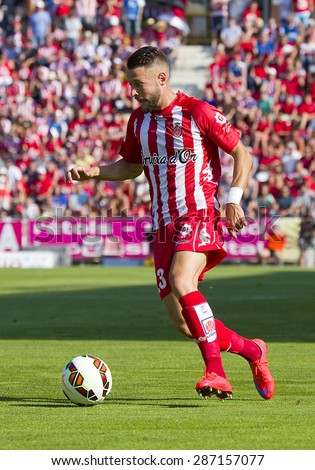 GIRONA, SPAIN - JUNE 7: David Junca of Girona in action at the Spanish Second Division League match between Girona FC and CD Lugo, final score 1 - 1, on June 7, 2015, in Girona, Spain. - stock photo