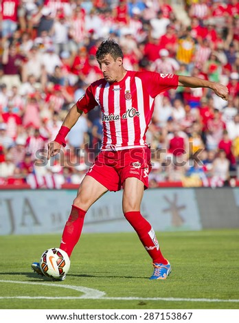 GIRONA, SPAIN - JUNE 7: Fran Sandaza of Girona in action at the Spanish Second Division League match between Girona FC and CD Lugo, final score 1 - 1, on June 7, 2015, in Girona, Spain. - stock photo