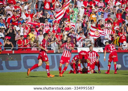 GIRONA, SPAIN - JUNE 7: Girona players celebrating a goal at the Spanish Second Division League match between Girona FC and CD Lugo, final score 1 - 1, on June 7, 2015, in Girona, Spain. - stock photo