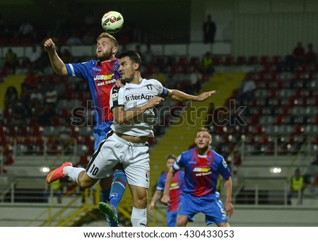 GIURGIU, ROMANIA - JULY 23, 2015: Daniel Devine and Constantin Budescu during the UEFA Europa League Second Qualifying Round game between Astra Giurgiu and Inverness on Marin Anastasovic Stadium. - stock photo