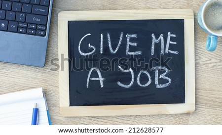 Give me a job written on a memo at the office - stock photo